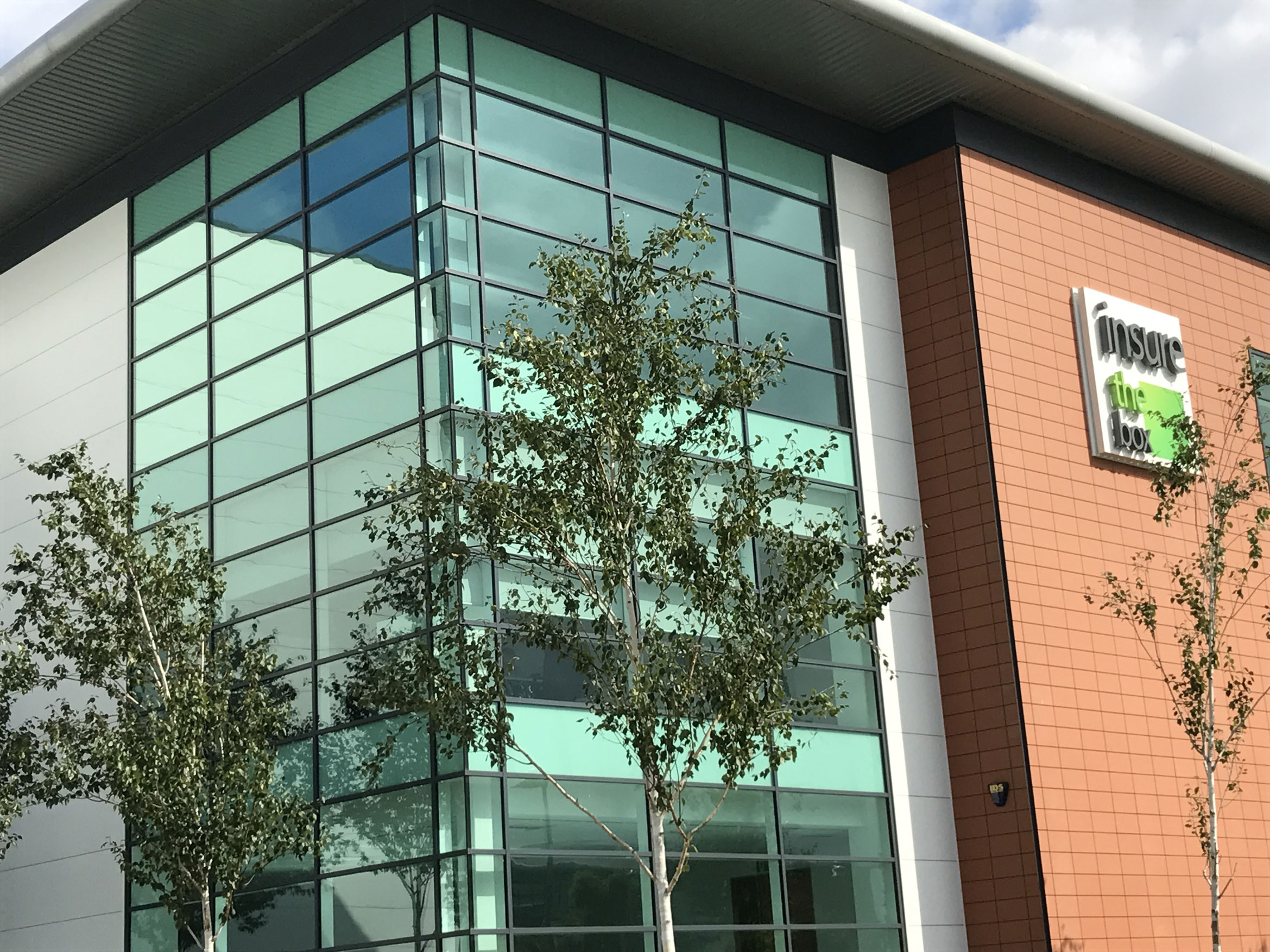 Reflective film fitted to windows at quorum business park to reduce glare and heat build up