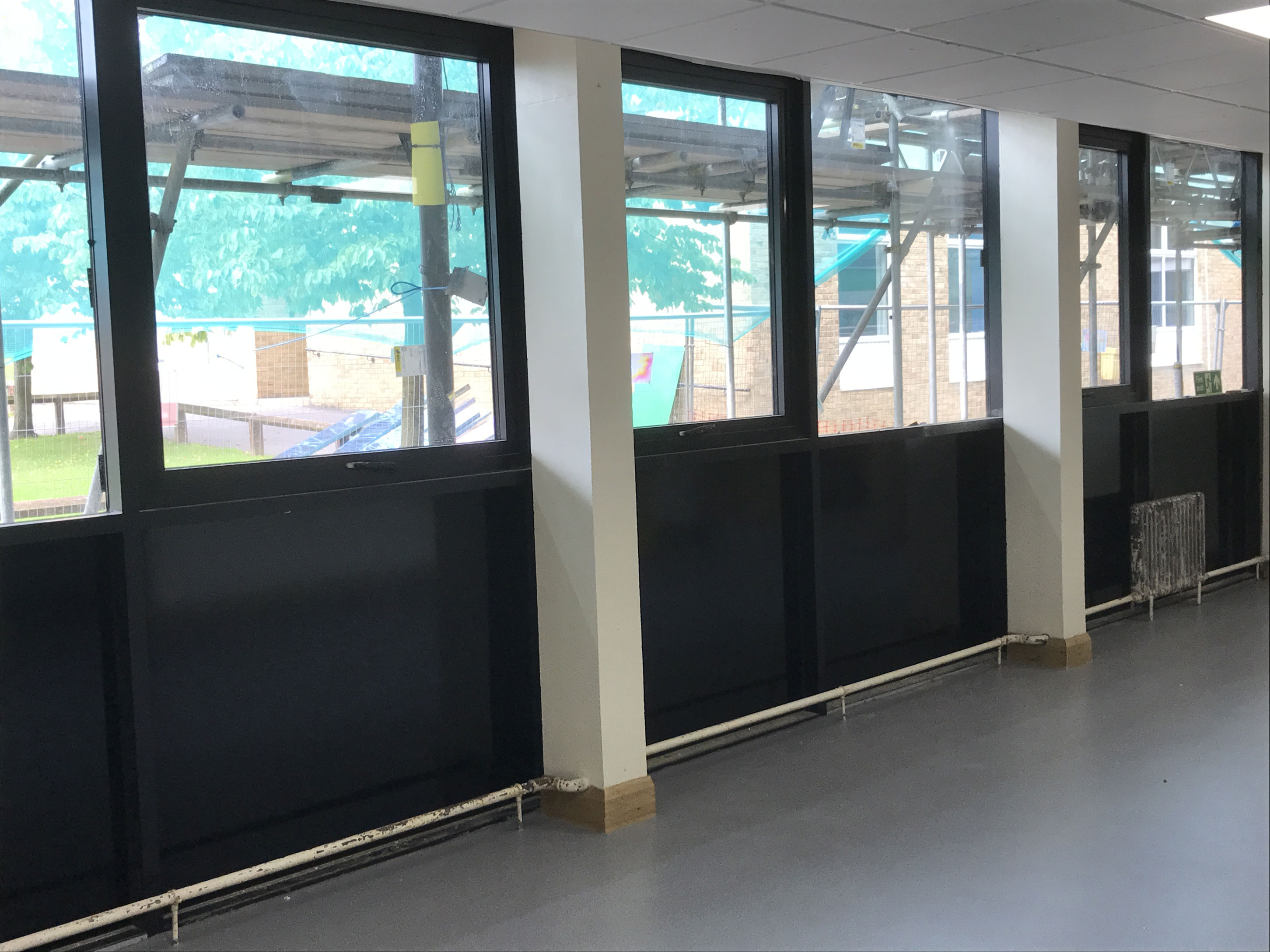 Black vinyl applied to low level glazing at Crook School Durham